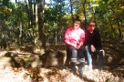 Friends pose in forest at Pinnacle Youth Park. Photo By Berkeley Lovelace Jr.