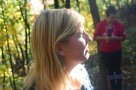 Sunlight glows on friends face inside the forest of Pinnacle Youth Park. Photo By Berkeley Lovelace Jr.