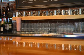 The bar table is holding mugs and other utensils before they are filled with liquor at Günter Hans Artisan Café on November 20, 2013. The size of the table ands its mug capacity reflect the volume of customers the local establishment receives. Photo by Berkeley Lovelace Jr.