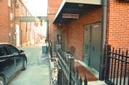 A gate enclosing Günter Hans Artisan Café on November 20, 2013. The bar is off the beaten path of downtown Columbia. Photo By Berkeley Lovelace Jr.